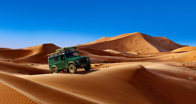 4 x4 Landrover Defnder on the Sahara sand dunes of erg Chebbi, Morocco, Africa