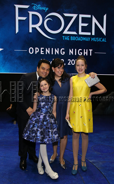 Kristen Anderson-Lopez and Robert Lopez with daughters during the Actors' Equity Opening Night Gypsy Robe Ceremony honoring Jeremy Davis for 'Frozen' at the St. James Theatre on March 22, 2018 in New York City.