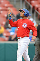 Buffalo Bisons outfielder Moises Sierra #14 after scoring a run during the first game of a double header against the Lehigh Valley IronPigs on June 7, 2013 at Coca-Cola Field in Buffalo, New York.  Buffalo defeated Lehigh Valley 4-3.  (Mike Janes/Four Seam Images)