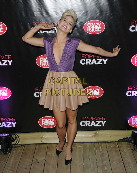 Kimberly Wyatt.Forever Crazy by Crazy Horse VIP Gala Night at South Bank, London, England..September 19th 2012.full length beige pink skirt purple smiling funny sleeveless plunging neckline top hands arms posing .CAP/CAN.©Can Nguyen/Capital Pictures.