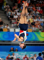 Aug. 9, 2008; Beijing, CHINA; Joey Hagerty (USA) performs on the floor exercise during mens gymnastics qualification during the Olympics at the National Indoor Stadium. Mandatory Credit: Mark J. Rebilas-