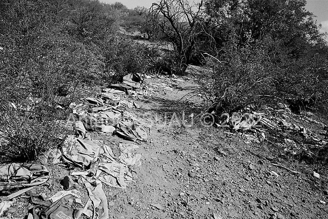Tucson, Arizona<br /> May 5, 2008<br /> <br /> A drop point for illegals just a few miles outside of Tucson. In this spot groups of illegal immigrants drop their water bottles, backpacks and other goods before walking onto a main road to be picked up by vehicle and then to a safe house within Tucson.<br /> <br /> The area is littered with thousands of backpacks and personal items that can give an a strong impression of how many illegals come in to this area over a short period of time.