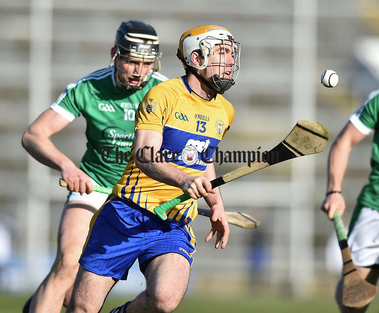 Conor Mc Grath of  Clare  in action against Gearoid Hegarty of  Limerick during their NHL quarter final at the Gaelic Grounds. Photograph by John Kelly.