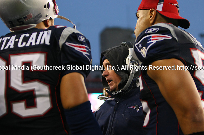 13December2009: New England head coach Bill Belichick calls a play as Junior Seau #55 and Tully Banta-Cain #95 listen in.  The New England Patriots defeated the Carolina Panthers 20-10 at Gillette Stadium in Foxborough, Massachusetts.