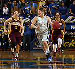BROOKINGS, SD - MARCH 27:  Tara Heiser #12 from South Dakota State University pushes the ball past Rachel Banham #1 and Sari Noga #15 from the University of Minnesota in the second half of their sweet sixteen gameThursday night at Frost Arena in Brookings. (Photo by Dave Eggen/Inertia)