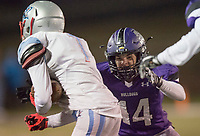 NWA Democrat-Gazette/CHARLIE KAIJO Fayetteville High School strong safety J Beasley (14) tries to stop Southside High School wide receiver Andre Rosa (1) during a playoff football game on Friday, November 10, 2017 at Fayetteville High School in Fayetteville.