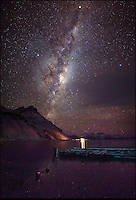 BNPS.co.uk (01202 558833).Pic: SamanthaCrimmin/BNPS..***Please Use Full Byline***..Milky Way over King Edward Point in South Georgia...A British Doctors braved freezing conditions to capture unique pictures of the night sky from the tiny British island of South Georgia in the remote South Atlantic...Amateur photographer Samantha Crimmin's stunning photos of the sky at night over South Georgia have left locals so star-struck they have been turned into stamps...Dr Samantha Crimmin was working as an emergency medic for the British Antartic Survey team when she took the celestial images in her spare time...Dr Crimmin used long exposures and plenty of patience to create the incredible shots that show star trails in a perfect circular motion...Her gallery of photos depict the night sky above different locations on the tiny outpost in the south Atlantic...They include one above the Harker Glacier - named after British geologist Alfred Harker - and over the wrecks of two Norwegian whaling ships at Grytviken.