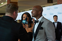 "ST. PAUL, MN JULY 16: Former Minnesota Viking Adrian Peterson talks to reporters on the red carpet at the Starkey Hearing Foundation ""So The World May Hear Awards Gala"" on July 16, 2017 in St. Paul, Minnesota. Credit: Tony Nelson/Mediapunch"