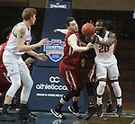SIOUX FALLS, SD - MARCH 9: Joel Okafor #20 of Indiana Wesleyan passes to teammate Evan Maxwell #50 as Cody Young #33 of IU Southeast defends at the 2018 NAIA DII Men's Basketball Championship at the Sanford Pentagon in Sioux Falls. (Photo by Dick Carlson/Inertia)