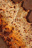 RUST<br /> Closeup Of Rusty Saw Blade<br /> Oxide of iron formed by corrosion, an electrochemical reaction.  In moist conditions iron is rapidly oxidized by oxygen to form rust, a mixture of iron oxides.