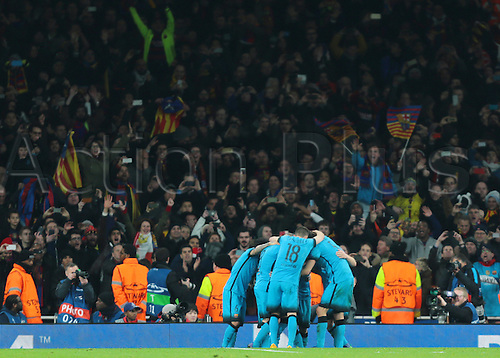 23.02.2016. Emirates Stadium, London, England. UEFA Champions League. Arsenal versus Barcelona.  Barcelona flags fly as Lionel Messi makes it 2-0 from the penalty spot, and celebrates with his team mates