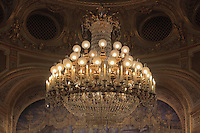 "Detail of the original chandelier lighting from the 19th century, Theatre Imperial Napoleon III de Fontainebleau (Fontainebleau Theatre Napoleon III), 1853-1856, by Hector Lefuel, Fontainebleau, Seine-et-Marne, France. Restoration of the theatre began in Spring 2013 thanks to an agreement between the Emirate of Abu Dhabi and the French Governement dedicating 5 M€ to the restoration.  In recognition of the sponsorship by the Emirate of Abu Dhabi, French Governement decided to rename the theatre as ""Theatre Cheikh Khalifa bin Zayed Al Nahyan"" (Cheikh Khalifa bin Zayed Al Nahyan Theatre). The achievement of a first stage of renovation will allow the opening of the theatre to the public on May 3, 2014. Picture by Manuel Cohen"