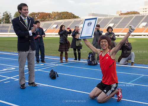 November 14, 2013, Tokyo, Japan - Kenichi Ito of Japan, known as the world's fastest man to run on four limbs, gestures after the announcement that he broke his 2012 100 meter run time in Tokyo, Japan, November 14, 2013. Ito was awarded a new Guinness World Records certificate as he logged a time of 16:87 seconds, breaking his time of 17:23 seconds last year. (Photo by Nippon News)