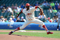 Touki Toussaint of Coral Springs Christian High School in Coral Springs, Florida delivers a pitch during the Under Armour All-American Game on August 24, 2013 at Wrigley Field in Chicago, Illinois.  (Mike Janes/Four Seam Images)