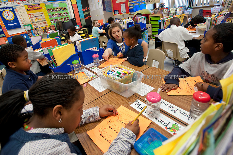3/26/2010--Seattle, WA, USA..Heidi Trudel leads her 2nd grade students in class at the Leschi Elementary School in Seattle. When the Seattle Public School system closed schools in the nearby Central District in 2009, including TT Minor Elementary school, many of the children were transferred to Leschi...©2010 Stuart Isett. All rights reserved.
