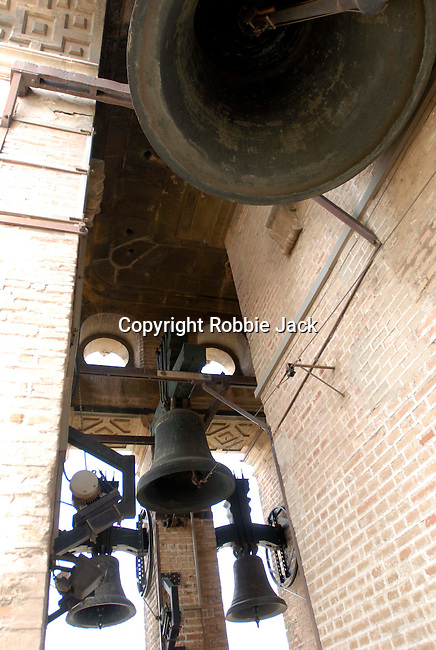 Bells in the Giralda tower at the Cathedral of Saint Mary of the See in Seville.The largest gothic cathedral in the world, it occupies the site of Hagia Sophia, a mosque built by the Almohads in the late 12th century. La Giralda, its bell tower, is a legacy from the Moorish structure.