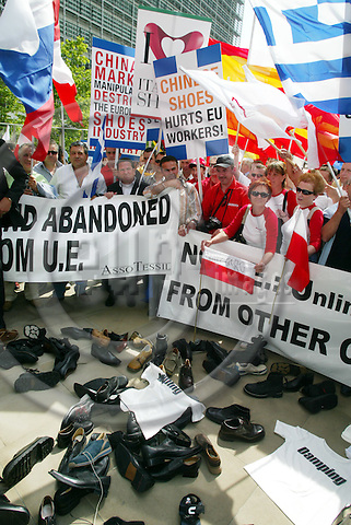 BRUSSELS - BELGIUM - 15 JUNE 2005 --Protesters from the European Confederation of the Footwear Industry during a demonstration in front of the European Commission headquarters. The European Union's shoe industry called for emergency duties on surging Chinese imports on Wednesday, urging the bloc to act urgently..-- PHOTO: ERIK LUNTANG / EUP-IMAGES..