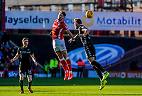 Barnsley's forward Tom Bradshaw (9) beats Leeds United's defender Liam Cooper (6) to the header during the Sky Bet Championship match between Barnsley and Leeds United at Oakwell, Barnsley, England on 25 November 2017. Photo by Stephen Buckley / PRiME Media Images.