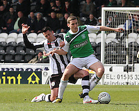 Paul Hanlon being tackled by Steven Thompson in the St Mirren v Hibernian Clydesdale Bank Scottish Premier League match played at St Mirren Park, Paisley on 29.4.12.