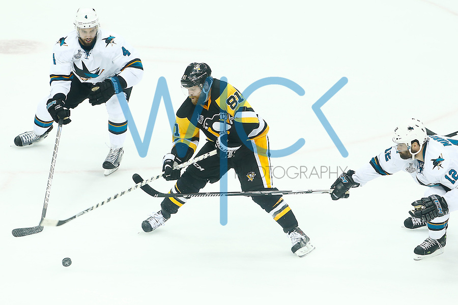 Phil Kessel #81 of the Pittsburgh Penguins carries the puck through the San Jose Sharks defense in the second period during game two of the Stanley Cup Final at Consol Energy Center in Pittsburgh, Pennslyvania on June 1, 2016. (Photo by Jared Wickerham / DKPS)