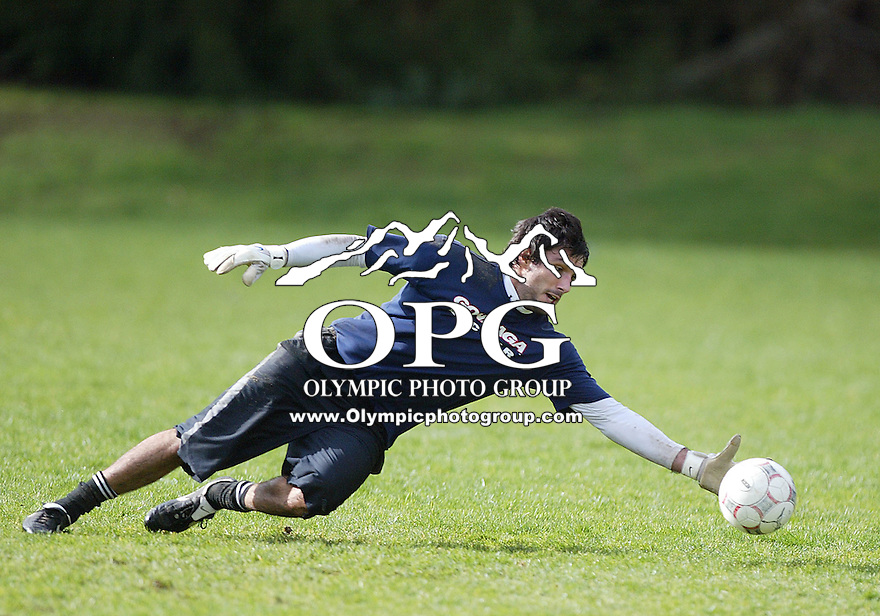 Feb 14, 2010: Former MLS keeper Vito Higgins stretches for a ball during keeper drills on Sunday at Gordon Field in Bremerton, WA.  The Kitsap Pumas held open tryouts to players wanting a chance to show case their soccer skills.