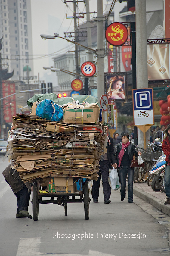 Carboard on a hand cart in Shanghai street..Shanghai, February 2006.