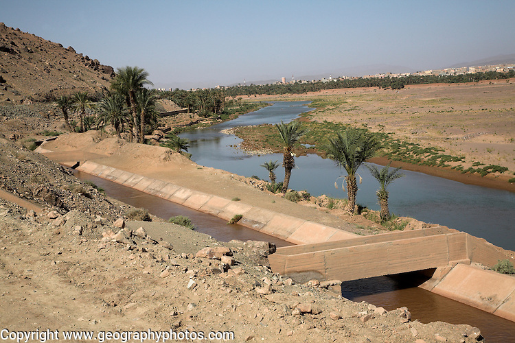 Sahara desert, Zagora, Morocco Irrigation channel of canalised river, Sahara desert, Zagora, Morocco, north Africa