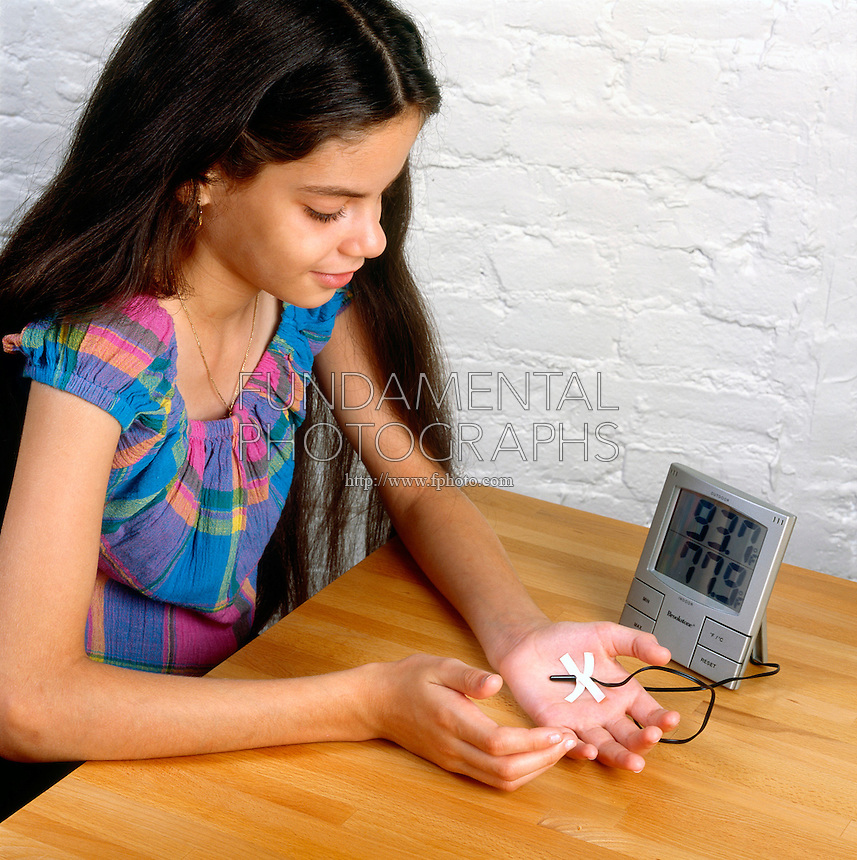MEASURING HEAT CAUSED BY FRICTION [2 of 2]<br /> (Variations Available)<br /> Using Indoor Outdoor Thermometer Sensor<br /> By taping the sensor of an indoor/outdoor themometer to her hand a student can measure the amount of heat generated by rubbing her hand together.