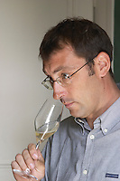 Pierre Larmandier, owner and winemaker, tasting a glass of his own champagne, Champagne Larmandier-Bernier, Vertus, Cote des Blancs, Champagne, Marne, Ardennes, France