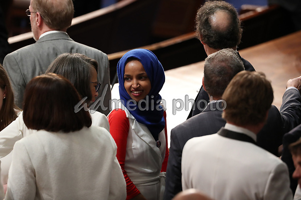 United States Representative Ilhan Omar (Democrat of Minnesota) on the floor prior to United States President Donald J. Trump delivering his second annual State of the Union Address to a joint session of the US Congress in the US Capitol in Washington, DC on Tuesday, February 5, 2019. Photo Credit: Alex Edelman/CNP/AdMedia