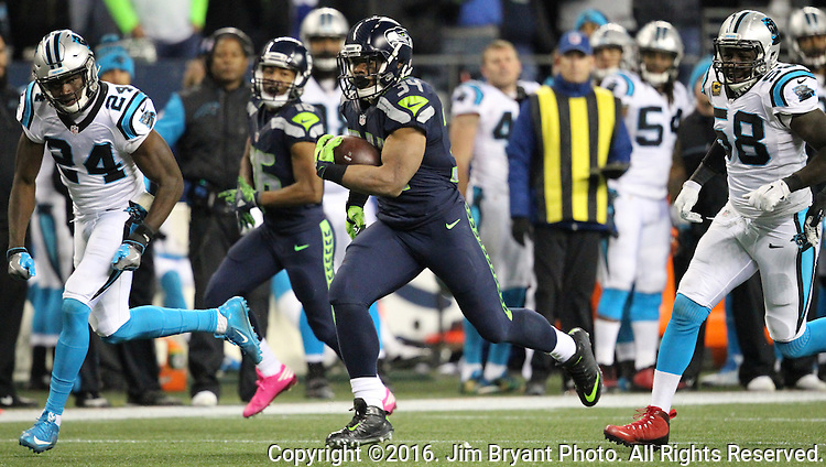 Seattle Seahawks running back Thomas Rawls (34) outruns Carolina Panthers cornerback James Bradberry (24) and outside linebacker Thomas Davis (58) on his way to a 45-yard touchdown in the second quarter at CenturyLink Field in Seattle, Washington on December 4, 2016. Rawls  scored two touchdowns in the Seahawks 40-7 win over the Panthers.  ©2016. Jim Bryant Photo. All Rights Reserved.