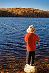 Young boy fishing in a Maine pond in the Autumn, Rockport, Knox County, Maine, USA