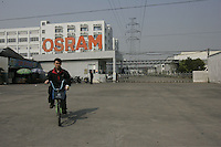 The Osram factory in foshan city, Guangdong Province, China, 16th January 2008. Osram China Lighting Ltd make energy saving light bulbs that are sold in the UK.