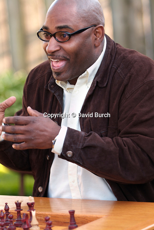 African American man playing chess excitedly