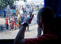 Perry Kitchen waves at fans from the bus. Spain defeated the U.S. Under-17 Men National Team  2-1 at Sani Abacha Stadium in Kano, Nigeria on October 26, 2009.