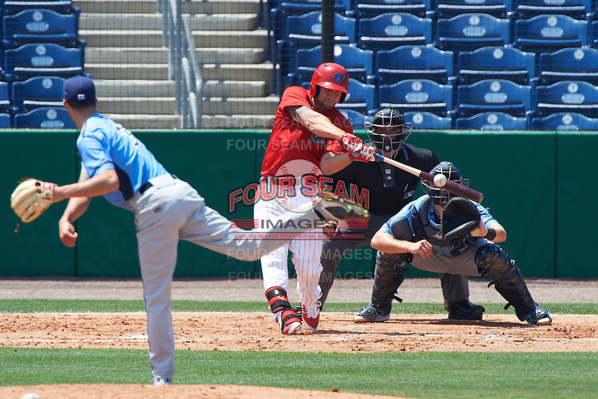 Clearwater Threshers designated hitter Kyle Martin (27) connects on a pitch from Hunter Wood (3) while at bat in front of catcher Mac James (8) and umpire Mike Savakinas during a game against the Charlotte Stone Crabs on April 13, 2016 at Bright House Field in Clearwater, Florida.  Charlotte defeated Clearwater 1-0.  (Mike Janes/Four Seam Images)
