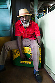 "JAMAICA, Port Antonio. Derrick ""Johnny"" Henry of the Mento band, The Jolly Boys playing the marumba box and performing at the Willow Wind Bar."
