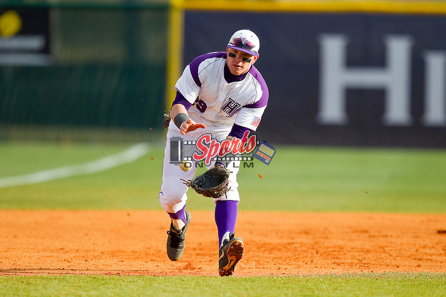 High Point Panthers third baseman Adam Barry (29) charges a ground ball during the game against the Ohio Bobcats at Willard Stadium on March 6, 2013 in High Point, North Carolina.  The Panthers defeated the Bobcats 4-1.  (Brian Westerholt/Sports On Film)