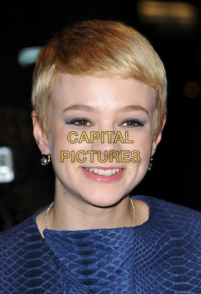 CAREY MULLIGAN .arriving at the ELLE Style Awards 2010, Grand Connaught Rooms, London, England, UK, .February 22nd 2010..outside arrivals portrait headshot earrings smiling  blue jacket animal print snake  .CAP/CAS.©Bob Cass/Capital Pictures