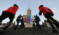 The Queens Canadian flag makes its way to be hoisted by Canada's Secretary to the Queen Kevin MacLeod to mark her Diamond Jubilee during a flag raising ceremony on Parliament Hill  in Ottawa on Monday, February 6, 2012. THE CANADIAN PRESS/Sean Kilpatrick