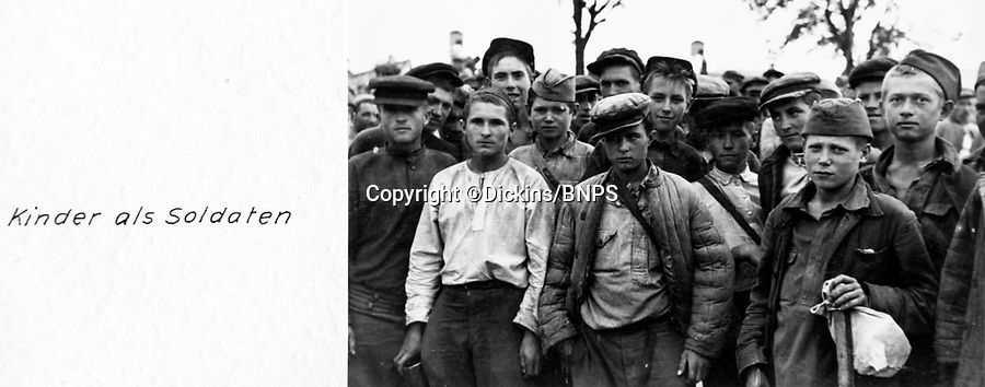 BNPS.co.uk (01202 558833)Pic: Dickins/BNPS<br /> <br /> Nazi Gold - von Richthofen's Barbarossa photo albums sell for £50,000 - auction house witnesses fierce battle over historic record of the Hitlers ill-fated Russian campaign.<br /> <br /> 'Children as soldiers'.<br /> <br /> Remarkable photograph albums compiled by a high-ranking Nazi which document the dramatic moment the tide turned against the Third Reich in the Second World War have been unearthed.<br /> <br /> Field Marshal Wolfram von Richthofen, who was the cousin of the First World War air ace the Red Baron, was a commanding officer in the German Luftwaffe during Operation Barbarossa - the invasion of the Soviet Union.<br /> <br /> His personal photos include haunting never seen before images of the Battle of Stalingrad in 1942 which is regarded by modern historians as Hitler's Waterloo.<br /> <br /> There is also a photo of Richthofen with General Freidrich Paulas, commander of the Sixth German Army, who incensed Hitler by surrendering with 91,000 men at Stalingrad rather than fighting to the last as the Fuhrer had ordered.
