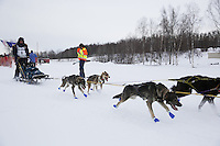 Jenny Greger and dog team leaves the start line of the 2013 Junior Iditarod on Knik Lake.  Knik Alaska..Photo by Jeff Schultz/IditarodPhotos.com   Reproduction prohibited without written permission