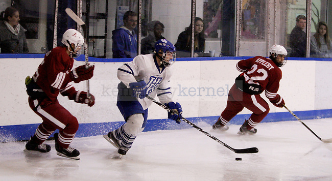 Sophomore defender Jacob Cohen breaks free from the Alabama offense to clear the puck during the University of Kentucky's men's club hockey game at the Lexington Ice Center in  Lexington, Ky., on Friday, October. 19, 2012.