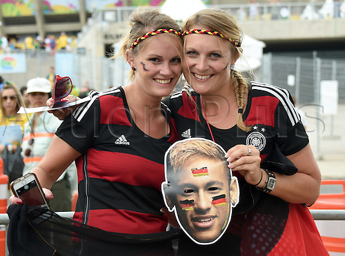 08.07.2014. Estadio Mineirao, Belo Horizonte, Brazil.  Supporters of Germany pose with a face mask depicting Brazilian soccer player Neymar prior to the FIFA World Cup 2014 semi-final soccer match between Brazil and Germany at Estadio Mineirao in Belo Horizonte, Brazil, 08 July 2014.