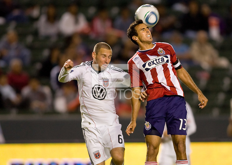 CD Chivas USA midfielder Jonathan Bornstein heads a ball past DC United midfielder Kurt Morsink. CD Chivas USA beat DC United 1-0 at Home Depot Center stadium in Carson, California on Sunday August 29, 2010.