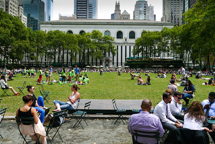 NEW YORK - AUGUST 9: Tourist and New Yorkers enjoy a summery park day in Bryant Park August 9, 2013 in New York City.