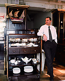 AUSTRIA, Vienna, the manager of Meinl Am Graben Restaurant standing by the cheese cart during lunch