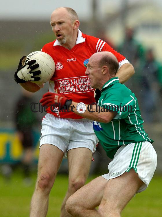 Corofins Colm Clancy holds off Kilrush's Donal O'Sullivan at Miltown.Pic Arthur Ellis.