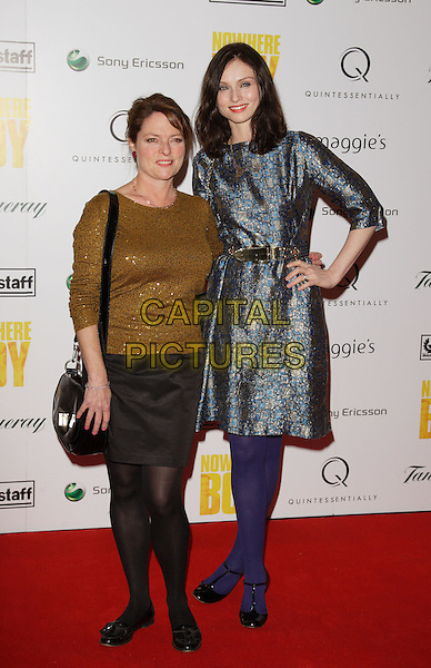 JANET ELLIS & SOPHIE ELLIS BEXTOR.Charity Screening of  'Nowhere Boy' held at BAFTA Piccadilly, London, England..November 26th, 2009.full length brown gold bronze sequins sequined top black skirt grey gray dress silver blue pattern print purple tights hand on hip belt bag purse t-bar shoes mother mom mum daughter family .CAP/ROS.©Steve Ross/Capital Pictures.