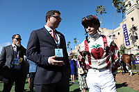 DEL MAR, CA - NOVEMBER 04: A jockey talks in the paddock during Day 2 of the 2017 Breeders' Cup World Championships at Del Mar Racing Club on November 4, 2017 in Del Mar, California. (Photo by Jesse Caris/Eclipse Sportswire/Breeders Cup)